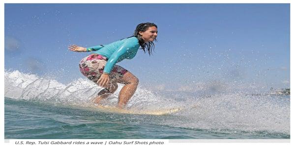 Tulsi Gabbard surfing